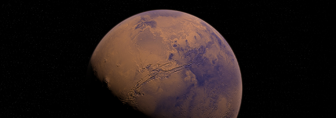 Orange and blue tinted photo of the planet Mars, partly in shadow