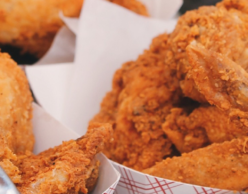 Paper plates of fried chicken