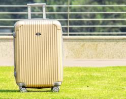 Yellow wheelie suitcase
